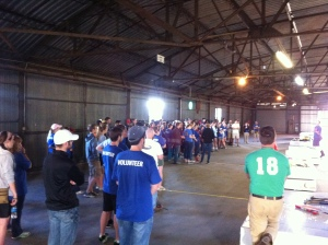 RUF students getting instructions before opening the shed packs to start building.